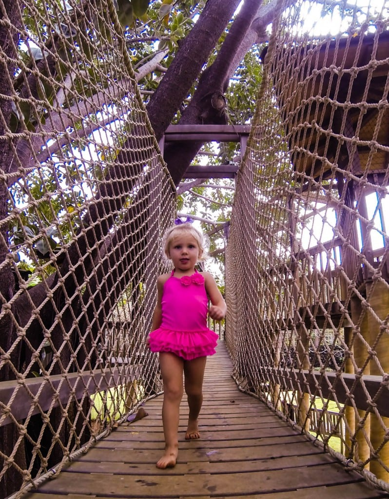Ashlyn finds the swinging bridge.