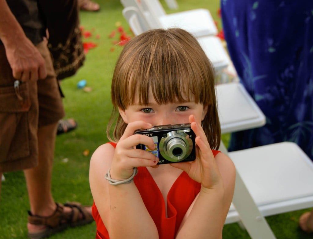 A youngster gets into the wedding spirit
